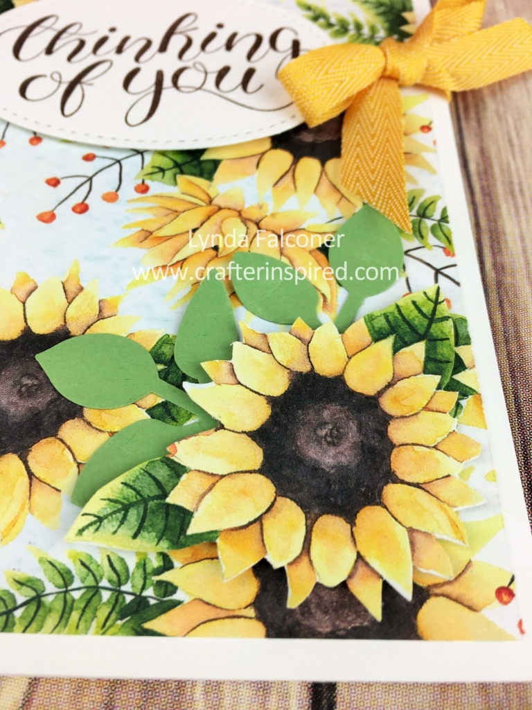 Close up of sunflower embellishment cut from Painted Autumn DSP and leaves from Leaf Punch by Stampin' Up Demonstrator Lynda Falconer at www.lyndafalconer.stampinup.net