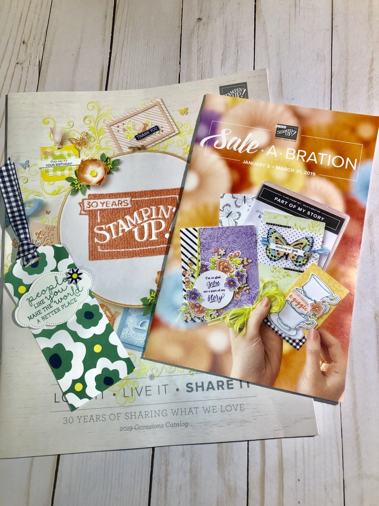 Spring 2019 Catalog packet from www.crafterinspired.com includes a handmade tag, Stampin' Up Occasions 2019 and Sale-A-Bration Catalaogs, shopping list
